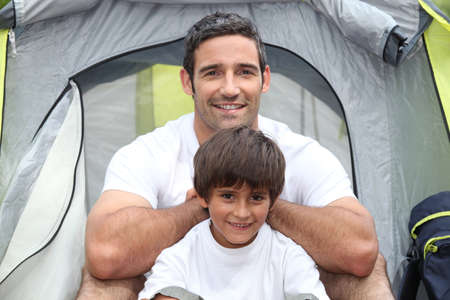 weekend break: Father and son camping Stock Photo
