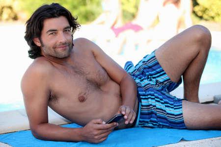settle back: Man on beach towel