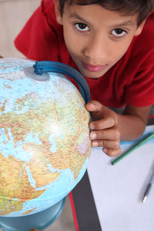 preteen boys: schoolboy interested in geography