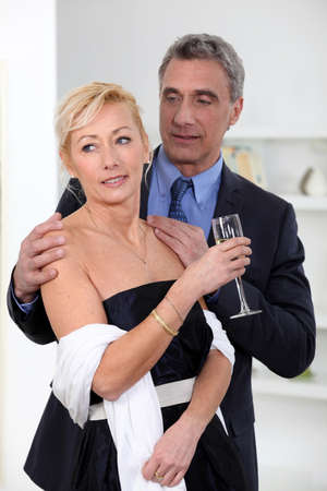 Formal couple drinking champagne photo