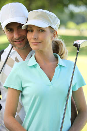 Couple golfing photo