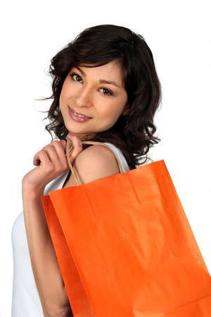 Young woman with a luxury store bag Stock Photo - 11797552