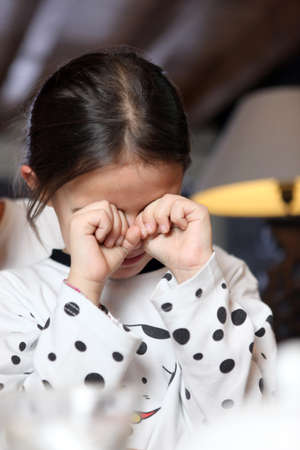 disquieted: Little girl rubbing her eyes
