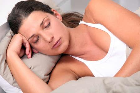 deeply: Young woman deeply asleep