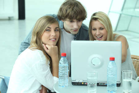 surfing the internet: Three teenager sat by computer