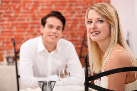 courting: Young couple on a date in a restaurant Stock Photo