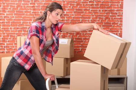 Woman dropping packing boxes photo