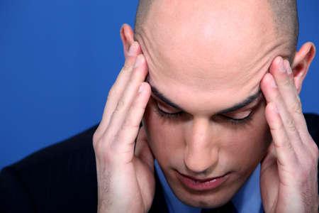 businessman having a head ache Stock Photo - 11797515