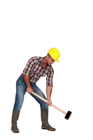 Labourer using a mallet photo