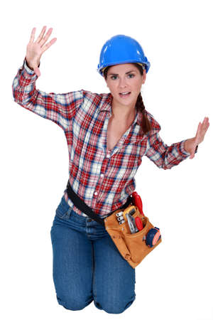 Female construction worker trapped in a small space Stock Photo - 11797317