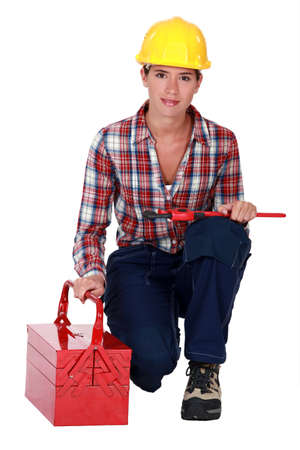 craftswoman: craftswoman holding a spanner and a toolbox Stock Photo
