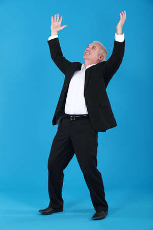 victorious: A victorious businessman. Stock Photo