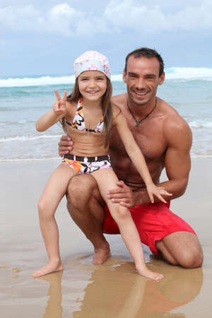 child swimsuit: Father and daughter at the seaside