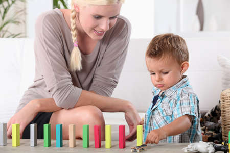 table skirt: Mother and son playing with domino