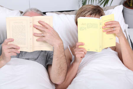 Couple reading together in bed photo