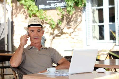 caf: Man sitting on a terrace