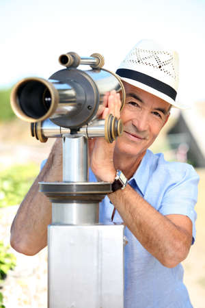Tourist looking through a telescope photo