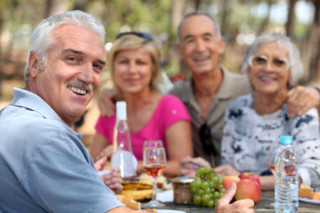 retired: Older couples enjoying an alfresco lunch