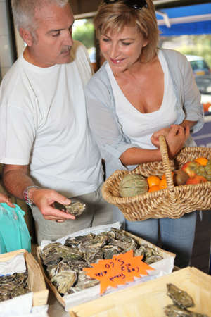 Couple buying oysters photo