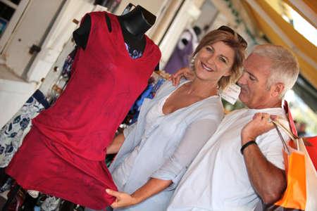 senior couple on vacation shopping photo