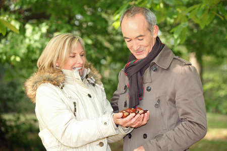 55 to 60: Couple collecting chestnuts
