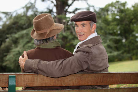 65 years old: portrait of older people on a bench