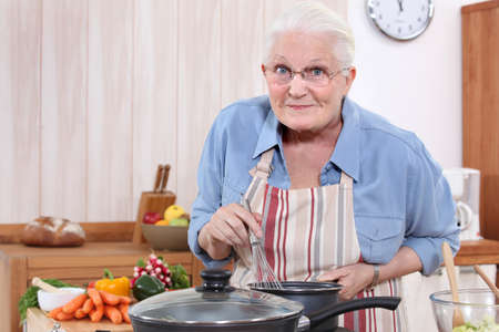 vegetable cook: grandmother cooking Stock Photo