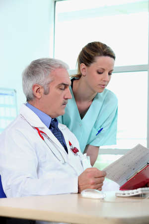 greying: doctor and nurse Stock Photo