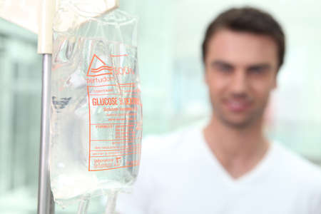 hospitalized: Man on an intravenous glucose drip Stock Photo