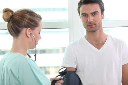 cuff: Nurse taking blood pressure