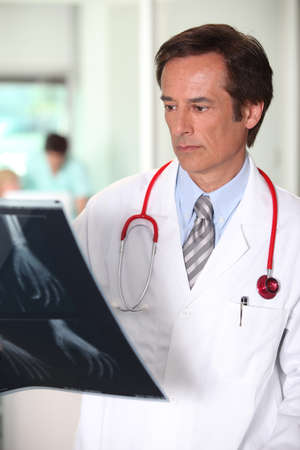 Male doctor analysing x-rap image Stock Photo - 11797300