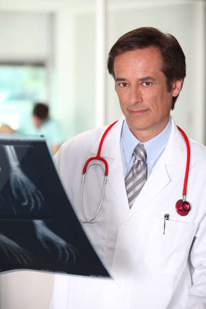 Doctor with x-ray image of hand photo