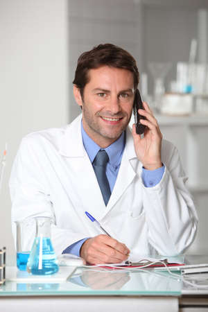 Laboratory technician on the telephone photo