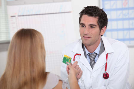 Physician meeting patient photo