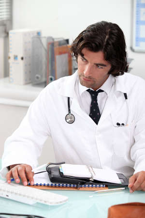 portrait of a doctor at desk Stock Photo - 11797512