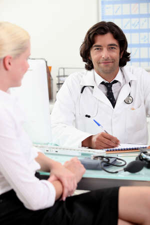 Doctor consulting with a patient Stock Photo - 11797539