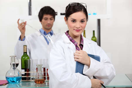 People working in a wine laboratory Stock Photo - 11797505