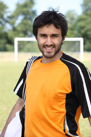 Male footballer stood in front of pitch Stock Photo - 11797209