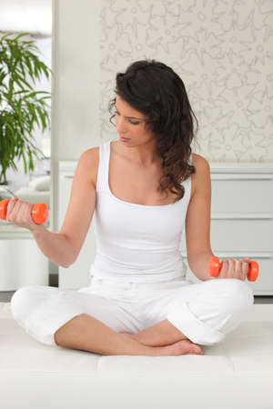 perspire: young woman training at home Stock Photo