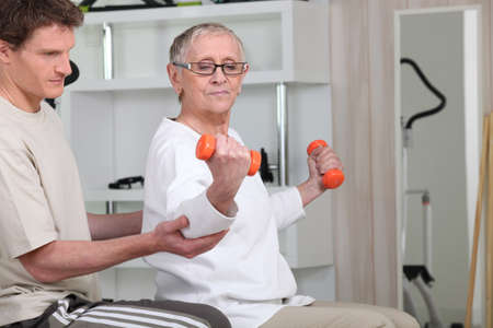 physical activity: senior woman doing exercises Stock Photo