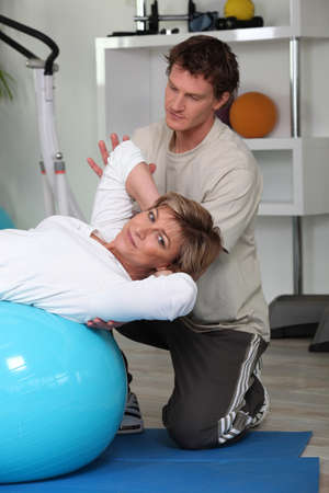 Woman with her personal trainer photo