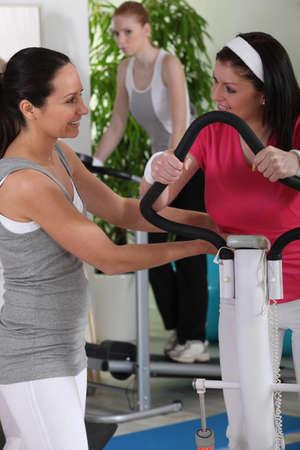 blabbing: Woman gossiping at the gym