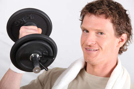 weightlifter: Man working out with a 2kg dumbbell Stock Photo