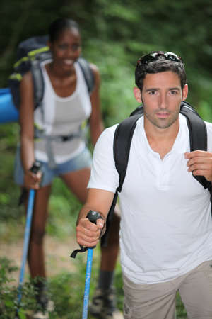 Interracial couple hiking photo
