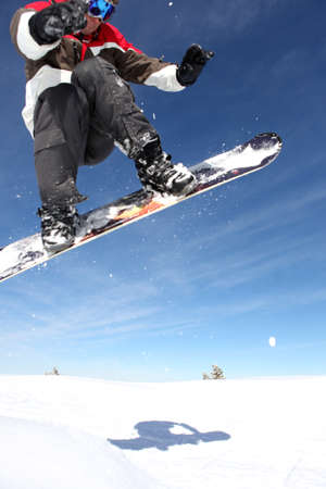pastimes: Snowboarder gliding through the air Stock Photo