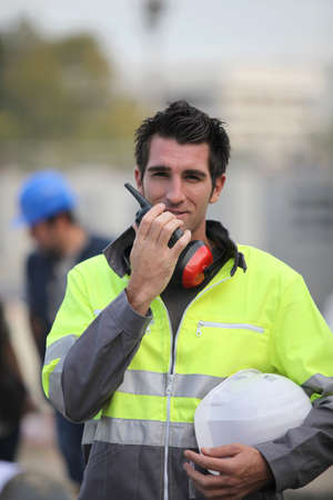 Construction worker with a walkie talkie photo