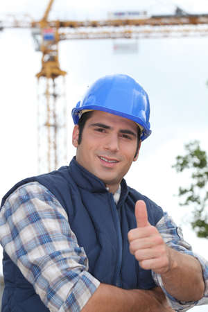 A construction worker giving the thumb up. photo