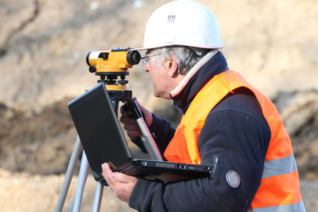 surveyor: A land surveyor using an altometer