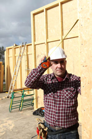 craftsman building a wooden house Stock Photo - 11796186