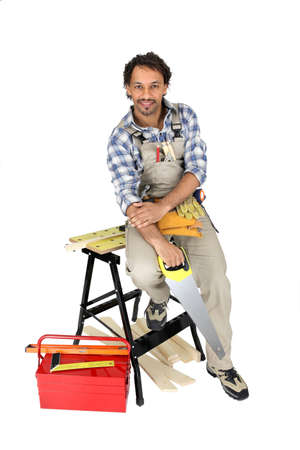 workmen: Carpenter with a handsaw Stock Photo